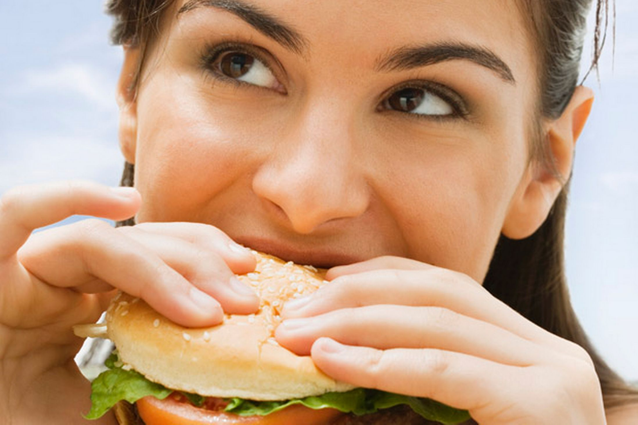 Teenage-girl-eating-a-hamburger-692189
